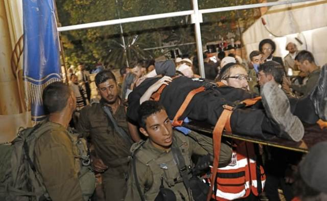 Two people are killed and 100 are injured when the grandstand seating at the Jerusalem Synagogue collapses.