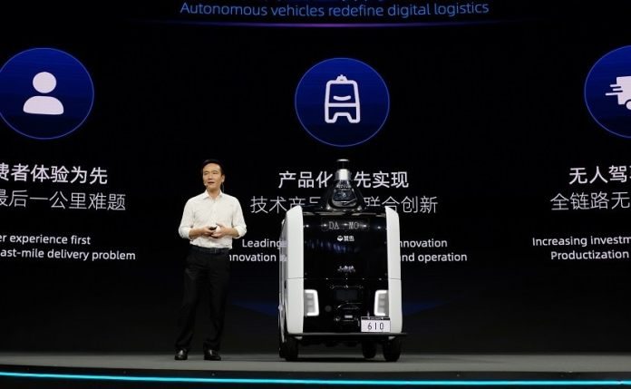 Cheng Li, CTO Alibaba, with the Cainiao autonomous delivery robot at the Global Smart Logistics Summit