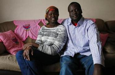 Yar Ayuel and her husband, Emmanuel Deng — working grad students, parents of three — at home in Arlington.