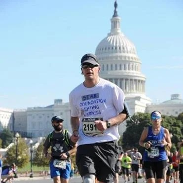 Sean Teare, a 48-year-old who has age-related macular degeneration, ran the Marine Corps Marathon last year.