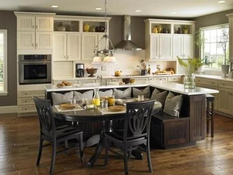 Having a kitchen island in a color different from that used for the cabinets at the perimeter gives a room depth. This example features Armstrong Town & Country cabinets.