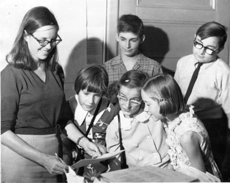 Kathrine Kane read a newspaper put out by a journalism workshop in 1968.
