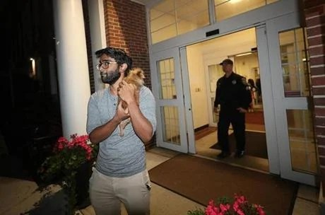 Andover, MA, 09/13/18, Andover residents were housed in the Senior Citizens Center. Shawn Daniel comes from Lawrence and the shelter at the Senior Center does not accept dogs, so he waited outside to see if he could return to his house. Suzanne Kreiter / Globe staff