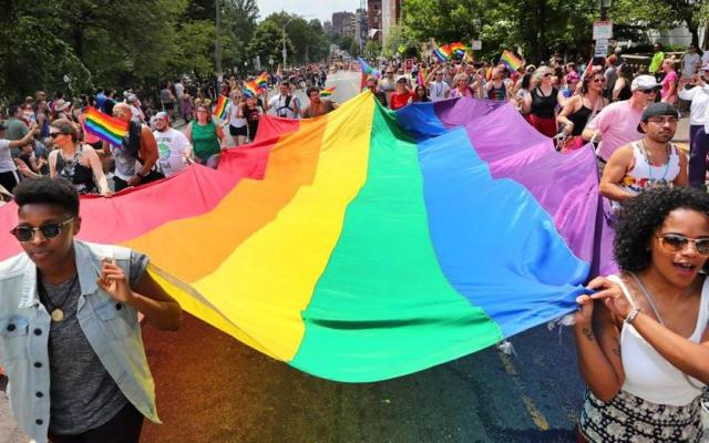 Participants in the 2017 parade carried a rainbow flag up Beacon Street.