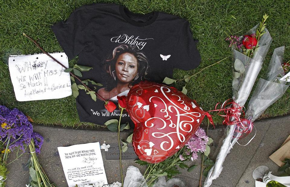 A T-shirt, flowers and notes were at a memorial today for Whitney Houston outside the Beverly Hills Hilton, where she died Saturday.