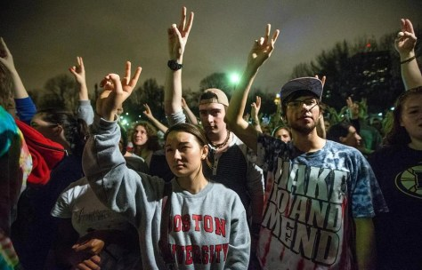 Yasmin Gentry (from left), TJ Dolan, and Hunter Stetz held their hands up during a moment of silence in the Boston Common.