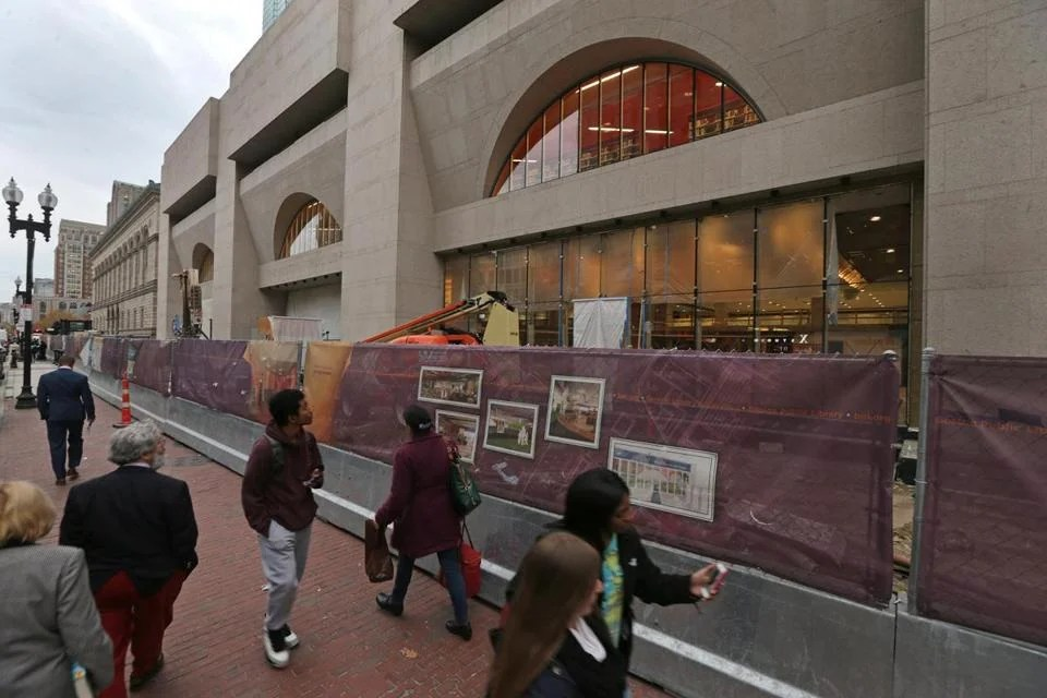 The 1970s Johnson Building until recently sat behind a stone wall; now, the BPL aims to draw more people in.