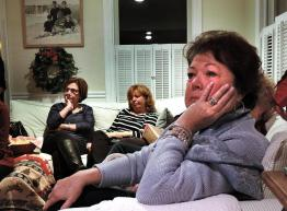 "Kathleen Greiner from Marstons Mills cried as she watched the HBO documentary film ""Heroin: Cape Cod, USA"" at support group. She was joined by Carla Ferraguto from Onset (left) and Maggy Purdy (center) of Sandwich."