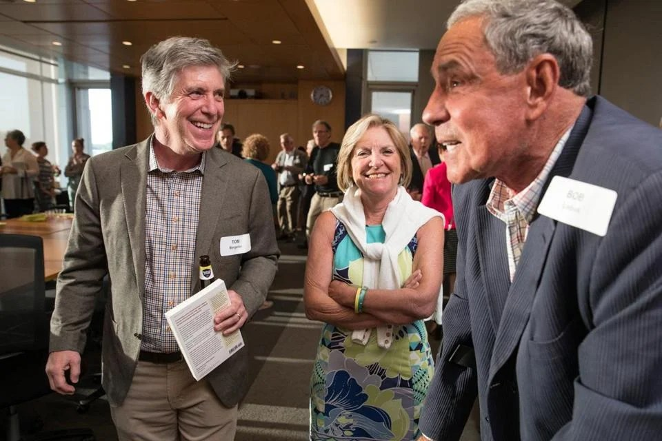 "Tom Bergeron (left) with Emily Rooney and Bob Lobel at a party at WGBH celebrating the new book ""The Golden Age of Boston Television."""