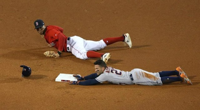 Jose Altuve was called out at second after a review.
