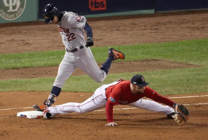 Steve Pearce brings Josh Riddick to first base in the seventh inning.