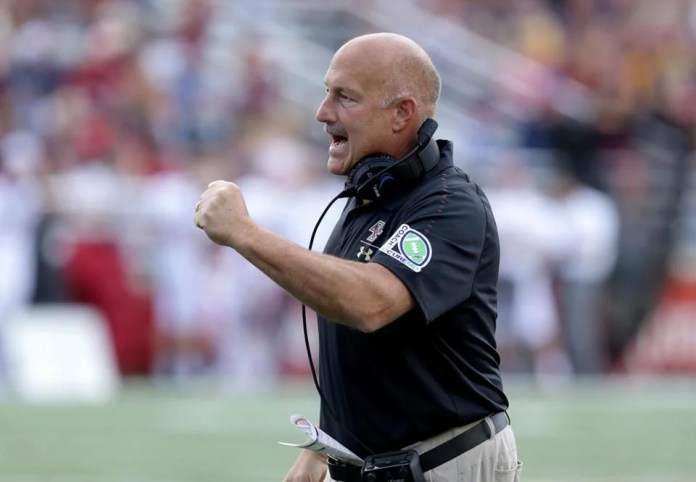 Coach Steve Addazio embraces the challenge of vying for attention in a pro sports town.