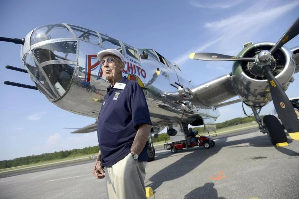 Doolittle Raider Lieutenant Colonel Richard ''Dick'' Cole, with a B-25 at a Raiders' reunion.