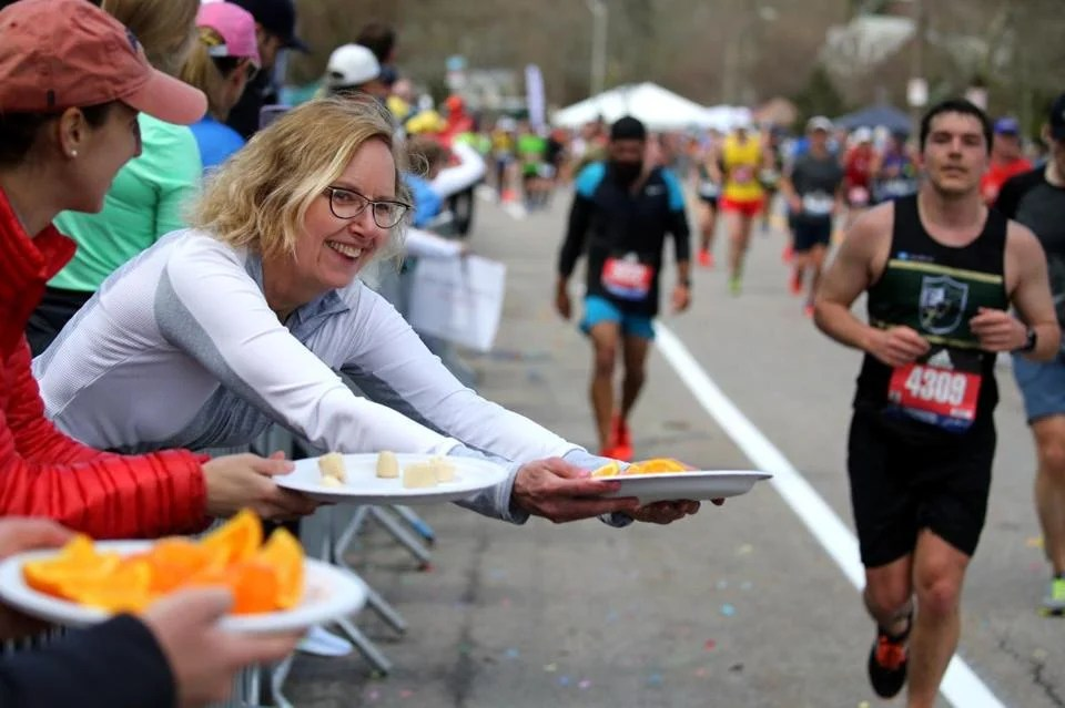 OK - so this is not a sign, but Susan Whoriskey was offering oranges for runners on Heartbreak Hill.