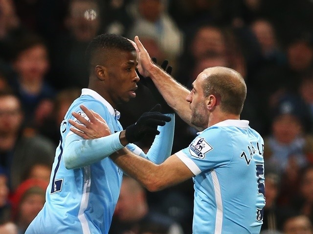 Kelechi Iheanacho celebrates scoring his goal with Pablo Zabaleta during the Premier League match between Manchester City and Tottenham Hotspur on February 14, 2016