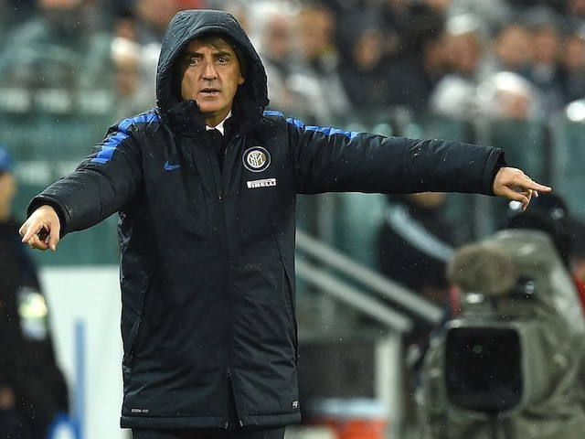 A hooded Roberto Mancini gives instructions during the Serie A game between Juventus and Inter on February 28, 2016