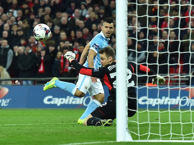 Simon Mignolet saves a Sergio Aguero shot during the League Cup final between Liverpool and Manchester City on February 28, 2016
