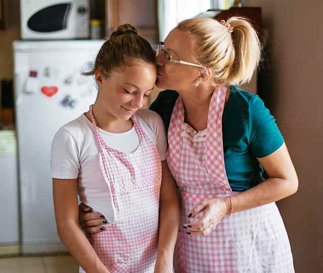 Mom Teaches Her Daughter How To Make A Dough By Mihajlo Ckovric For Stocksy United