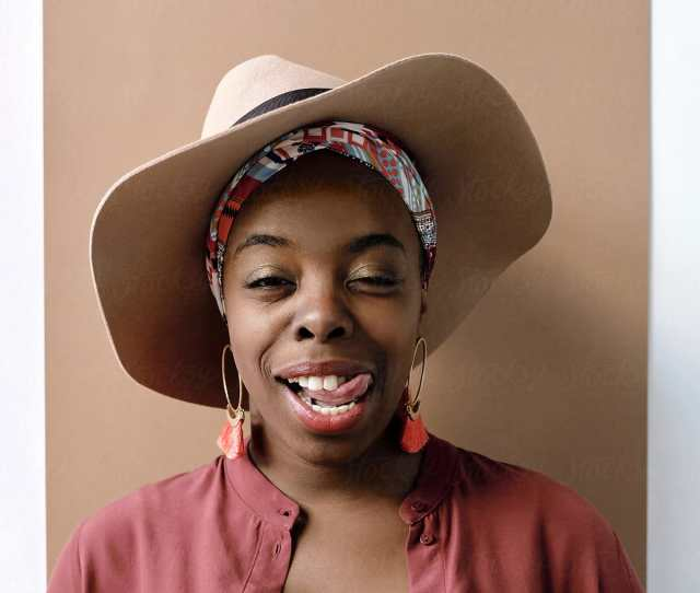 Stylish Black Woman Showing Tongue By Clique Images For Stocksy United