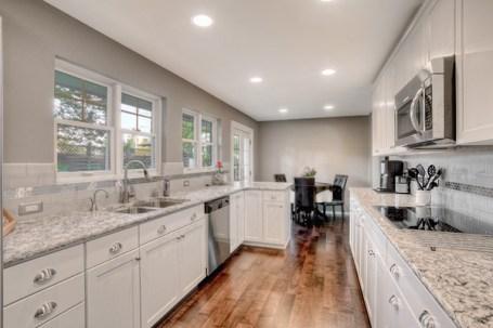 Grey eat-in galley kitchen