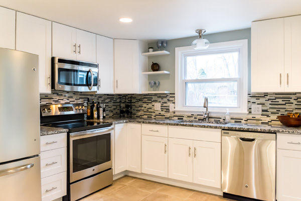 Shaker-style white kitchen cabinets in home