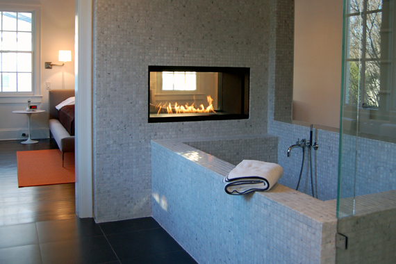 tile fireplace in bathroom over tub
