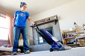 Woman vacuuming during spring cleaning