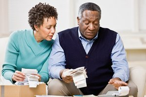 Couple looking at receipts for 2009 tax return