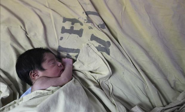 A baby is seen inside the childbirth unit at hospital Escuela in Tegucigalpa