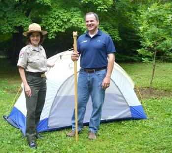 Photo of Secretary Mark Belton and Parks Superintendent Nita Settina at campgound