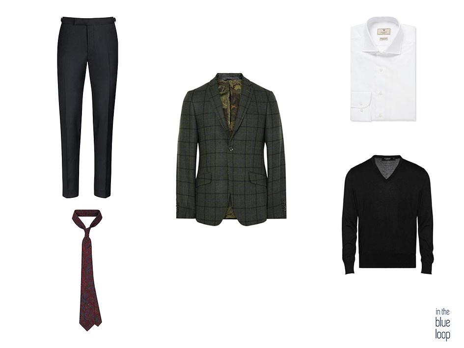 Look smart casual masculino con blazer de cuadros, jersey, camisa blanca, corbata estampada y pantalones negros