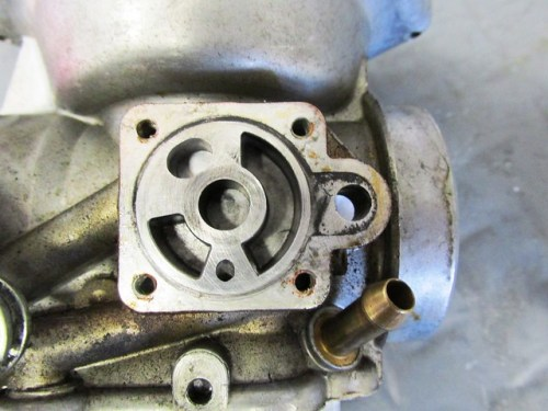 Right Carburetor Choke Housing with Disk Removed