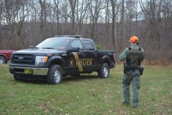 Photo of Maryland Natural Resources Police officer and vehicle