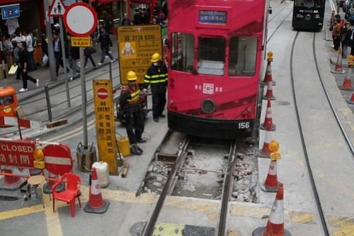 Tram #156 passes over a short stretch of relaid track, minus concrete