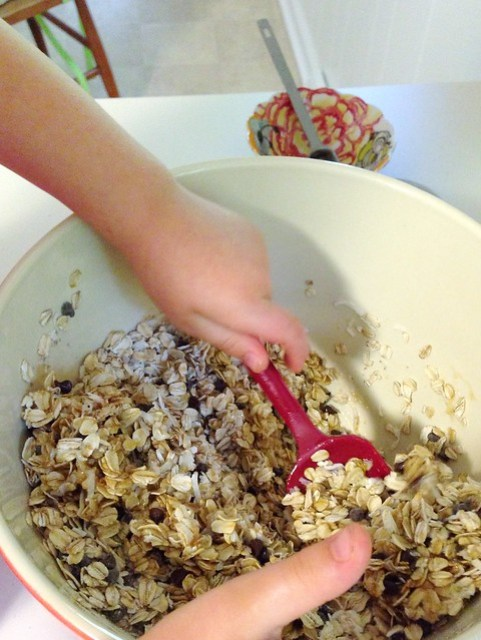 stirring up ingredients for chocolate chip granola bars