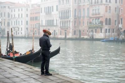 Lone Gondolier in Venice Italy