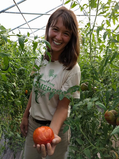 Sarah Longstreth showing off a tomato