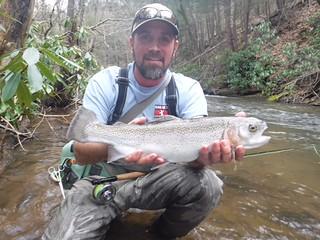 Man holding rainbow trout
