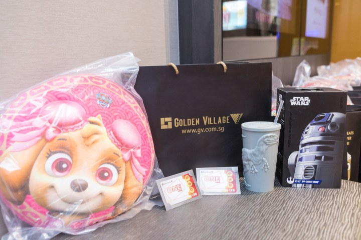 The contents of Mr Lee's goodie bag includes an R2-D2 Sphero, a pair of gift cards, a Jurassic World tumbler and a Paw Patrol cushion. Photo: Golden Village