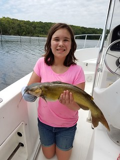 Photo of girl holding channel catfish
