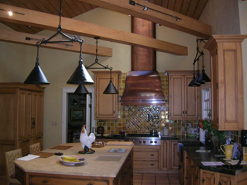 Wall Mounted Bell Hood With Tall Stack On Vaulted Ceiling