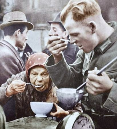 German Soldier Has Lunch With Old Woman Poland