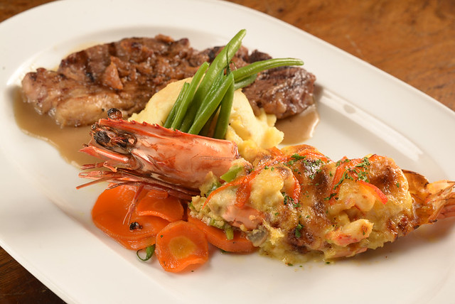 Rib Eye and Prawn Thermidor