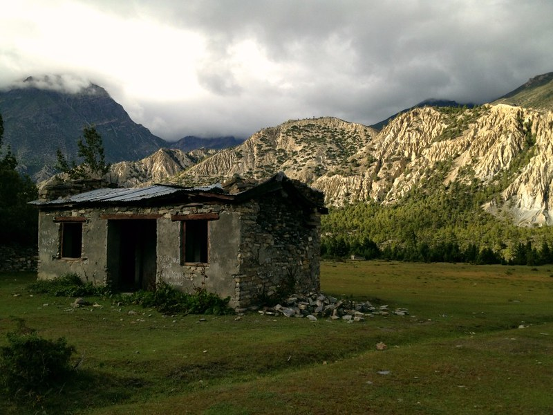 abandoned stone hut in annapurna valley