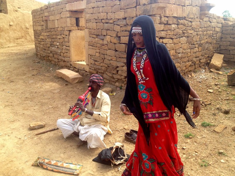 gypsy father and son duet playing flute and singing in thar desert in india