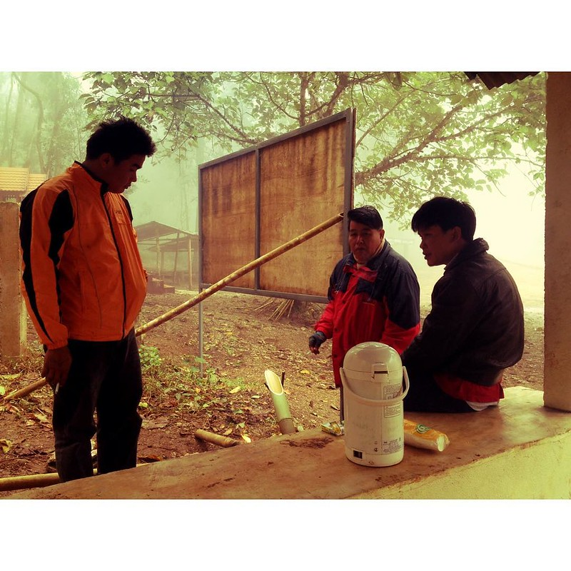 thai men drinking tea in the forest