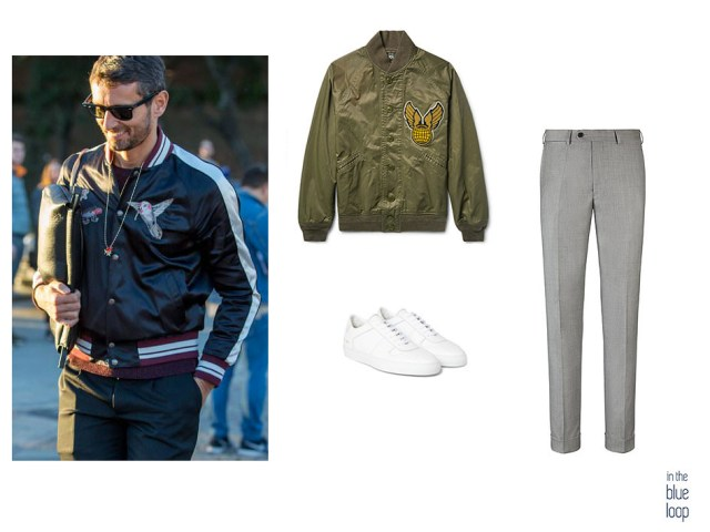 El pantalón gris, unas zapatillas blancas y una bomber con parches crea un look para hombre impecable