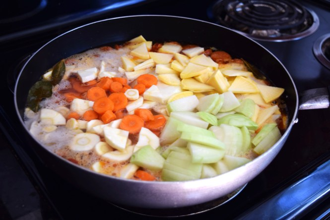 Add root vegetables to boiling barley stew