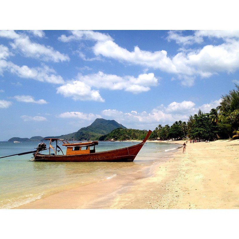 long tail boat at beach on koh jum island in thailand