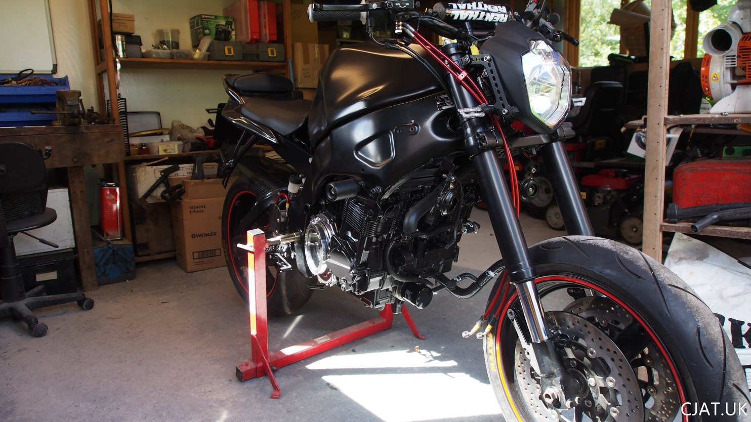 suzuki rf900 braided brake lines and new headlight with USD forks from a gsxr1100